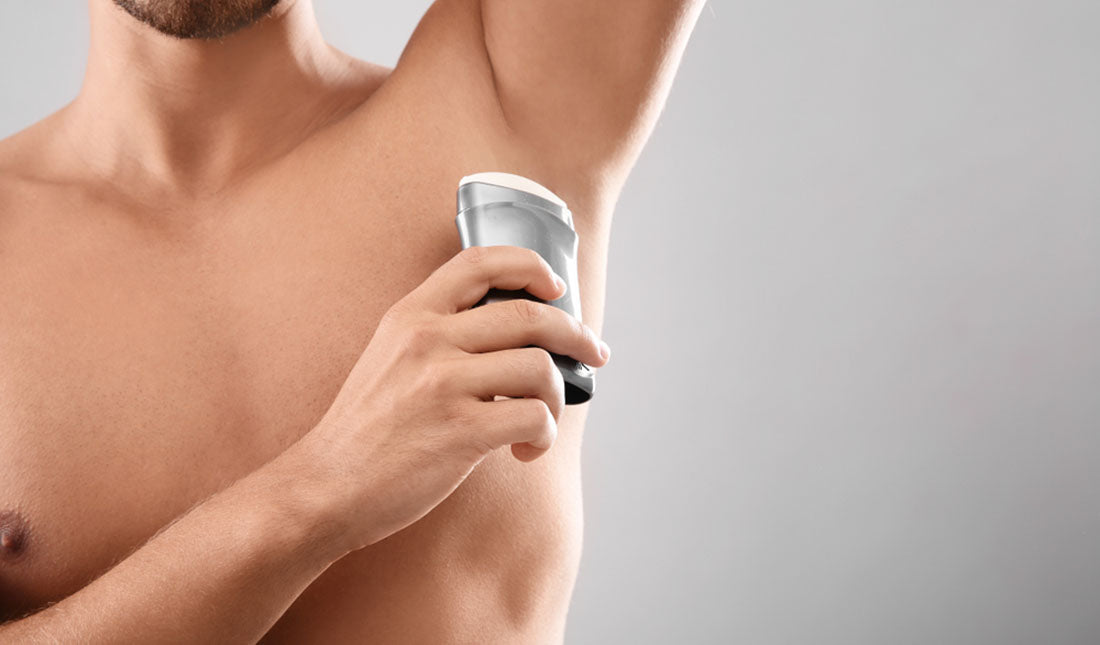 applying under arm deodorant