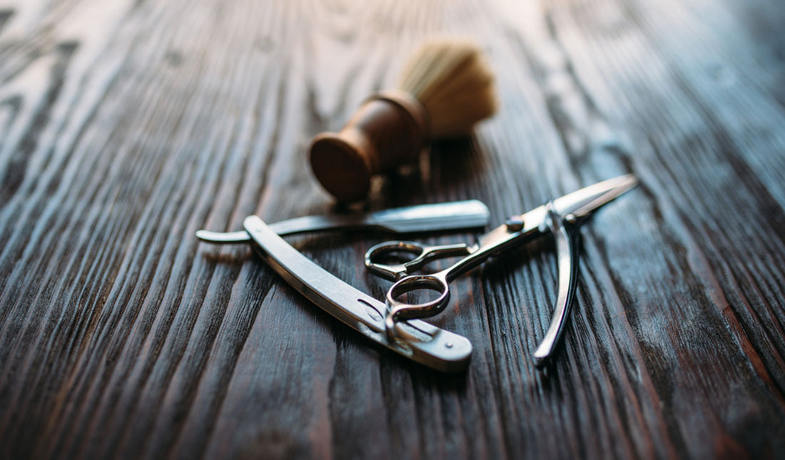 barbers tools on wooden surface