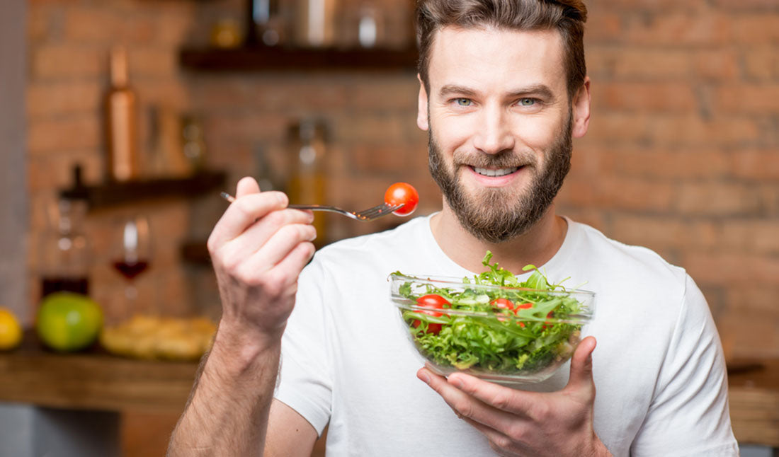 bearded man eating salad