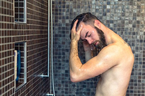 bearded man showering