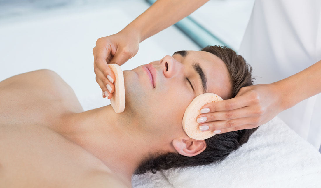 man receiving facial treatment