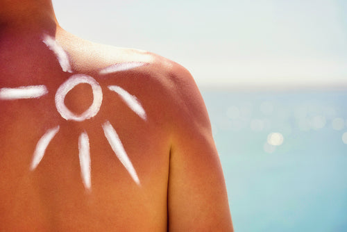closeup of sunscreen on shoulder