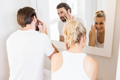 couple checking skin in mirror