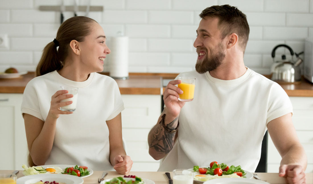 couple enjoying dinner in kitchen