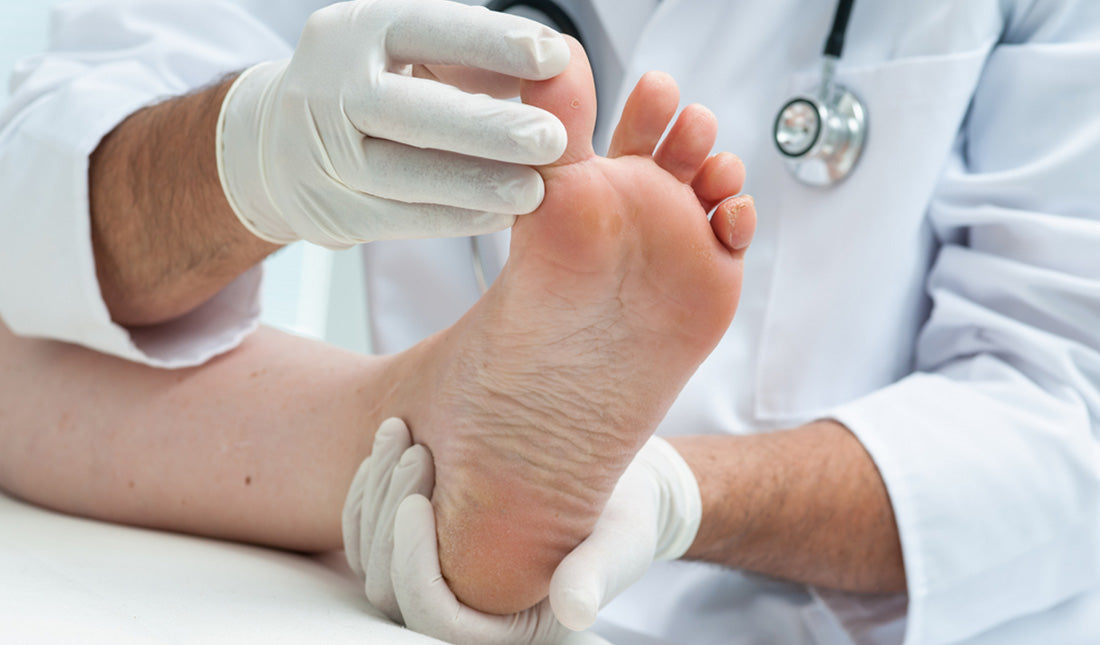 dermatologist examines foot