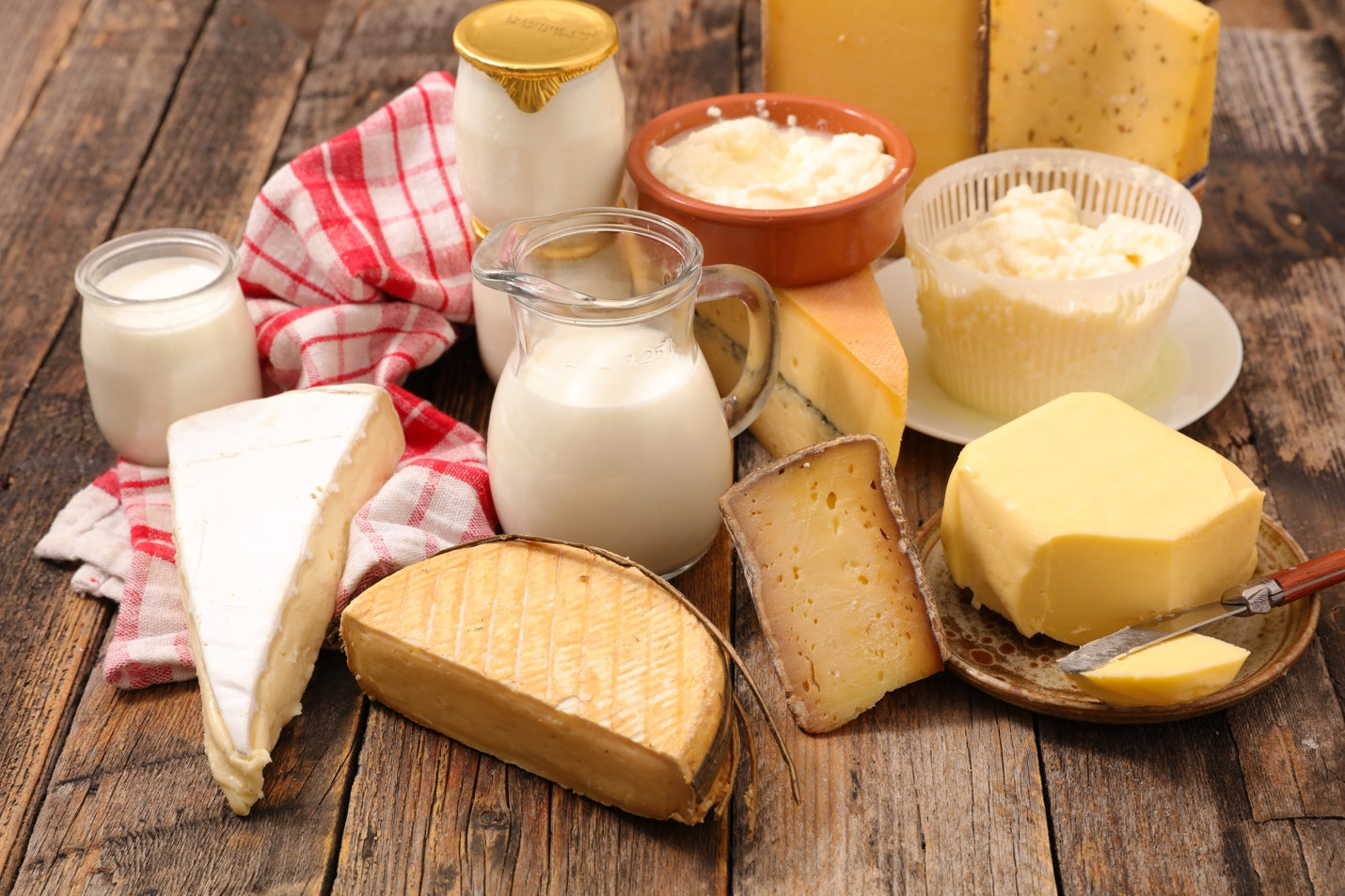Different dairy products on a wood table