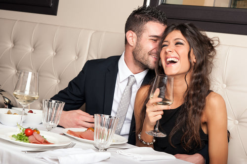 elegant young couple drinking cocktail