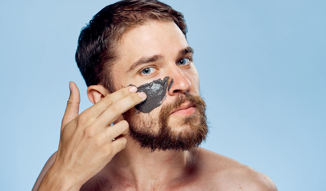 guy applying face mask