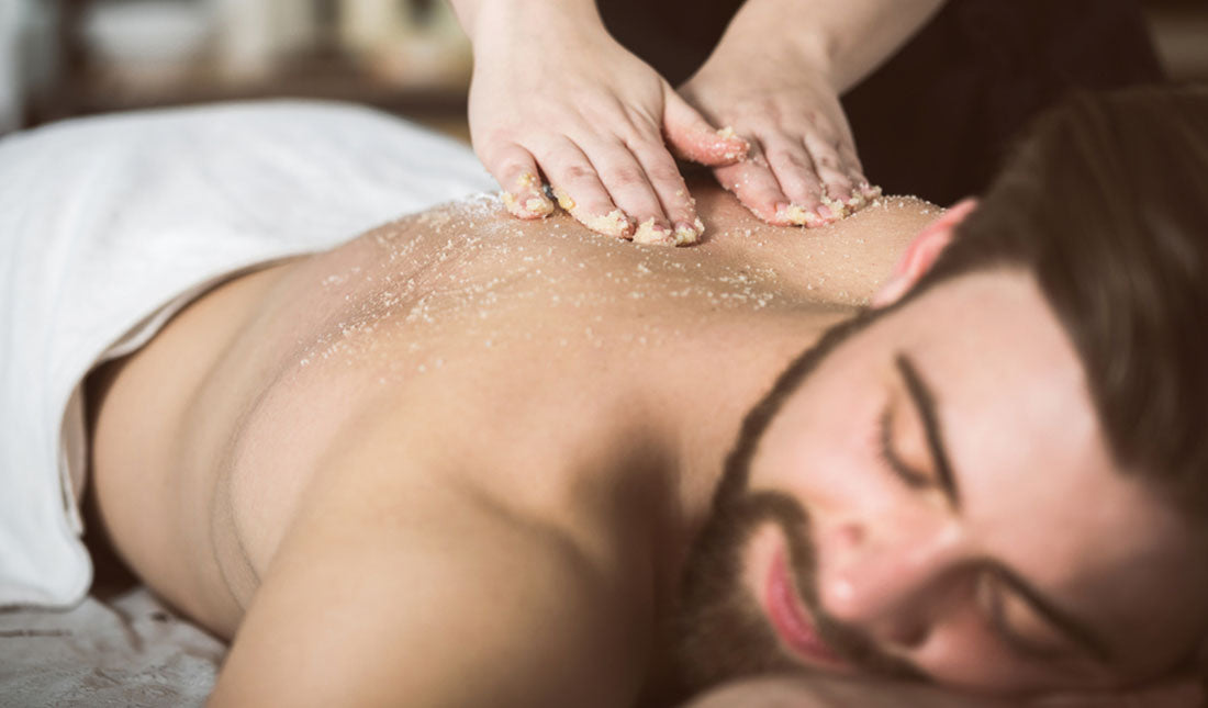 guy receiving exfoliating massage