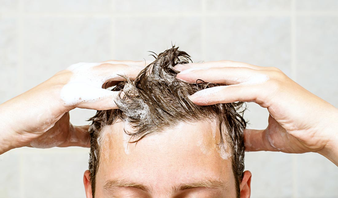 guy washing hair closeup