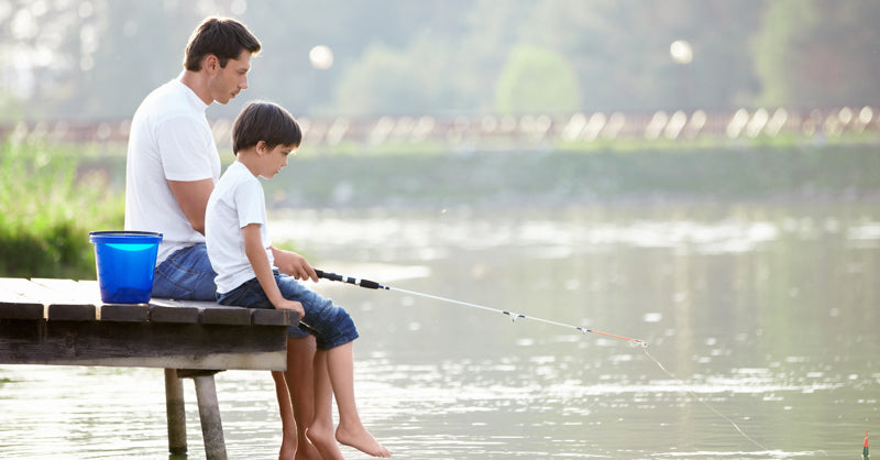Young father and son fishing