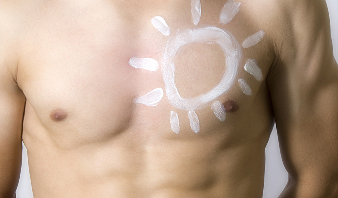 man applying sun protection