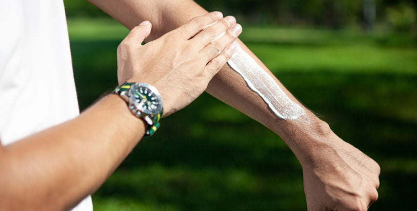 applying sunscreen to forearm