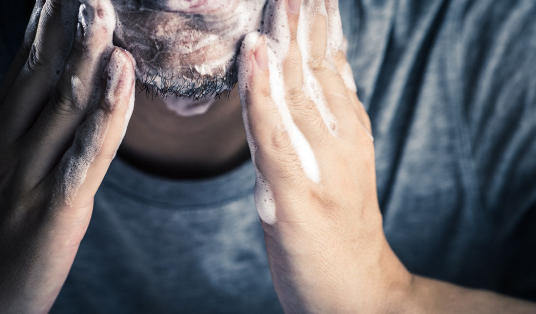 man cleansing face