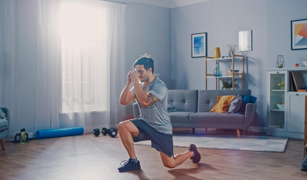 man doing lunges in living room