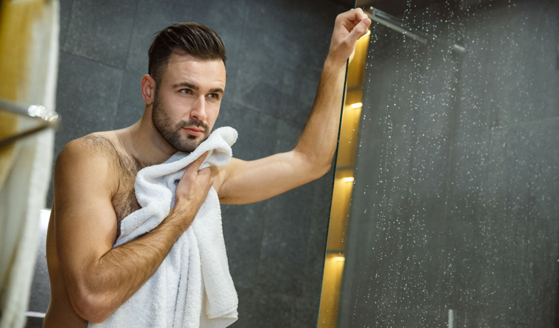 man drying off after shower