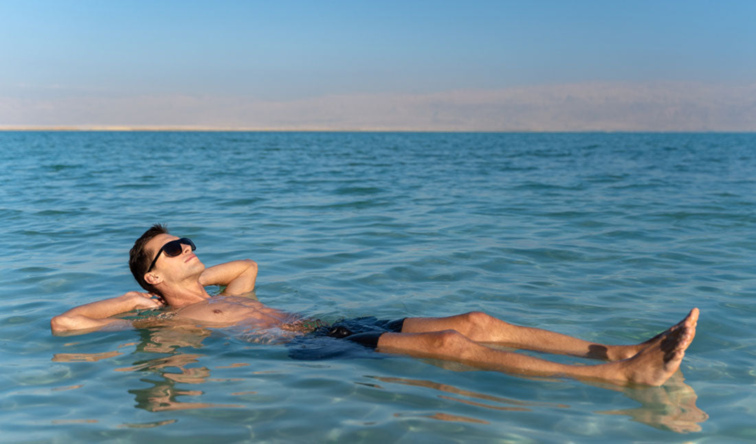man floating in salty dead sea