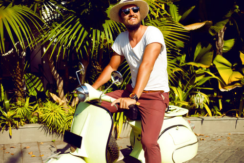 man riding vespa