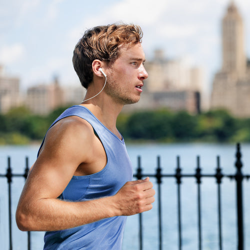 man running listening to headphones