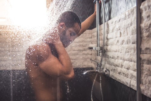 man standing in shower