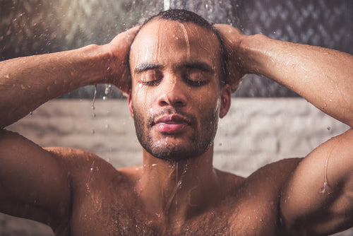 closeup of man taking shower