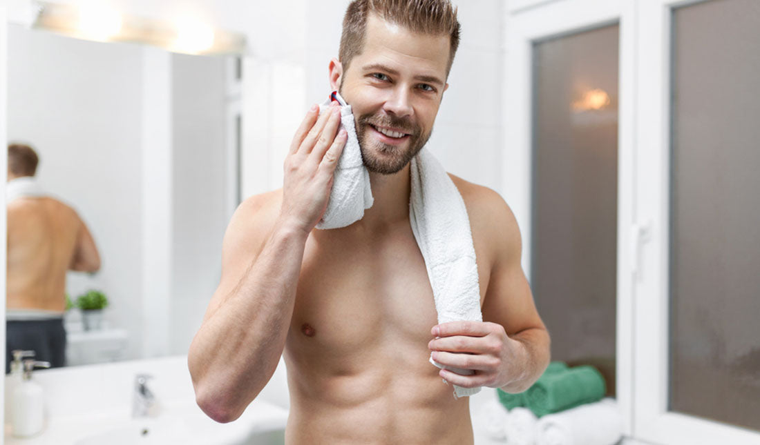 man drying face with towel