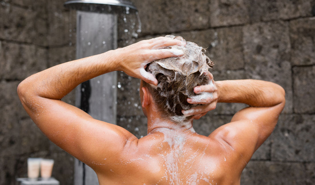 man washing scalp