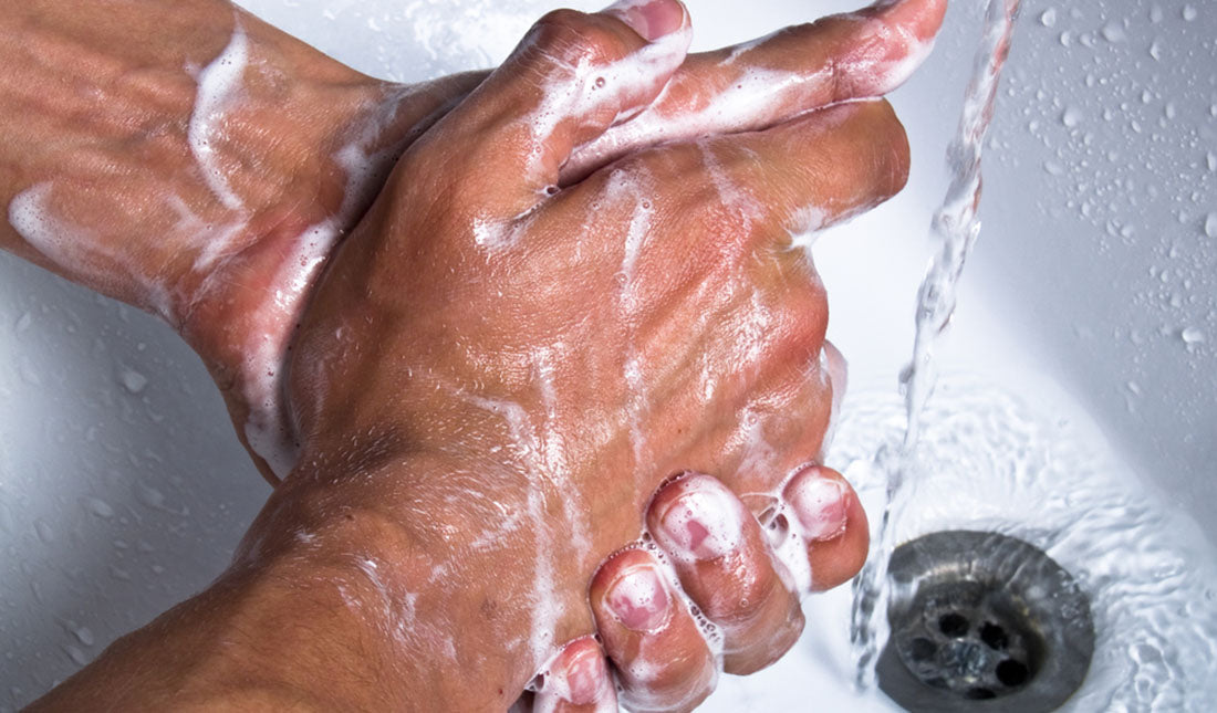 man washing soapy hands