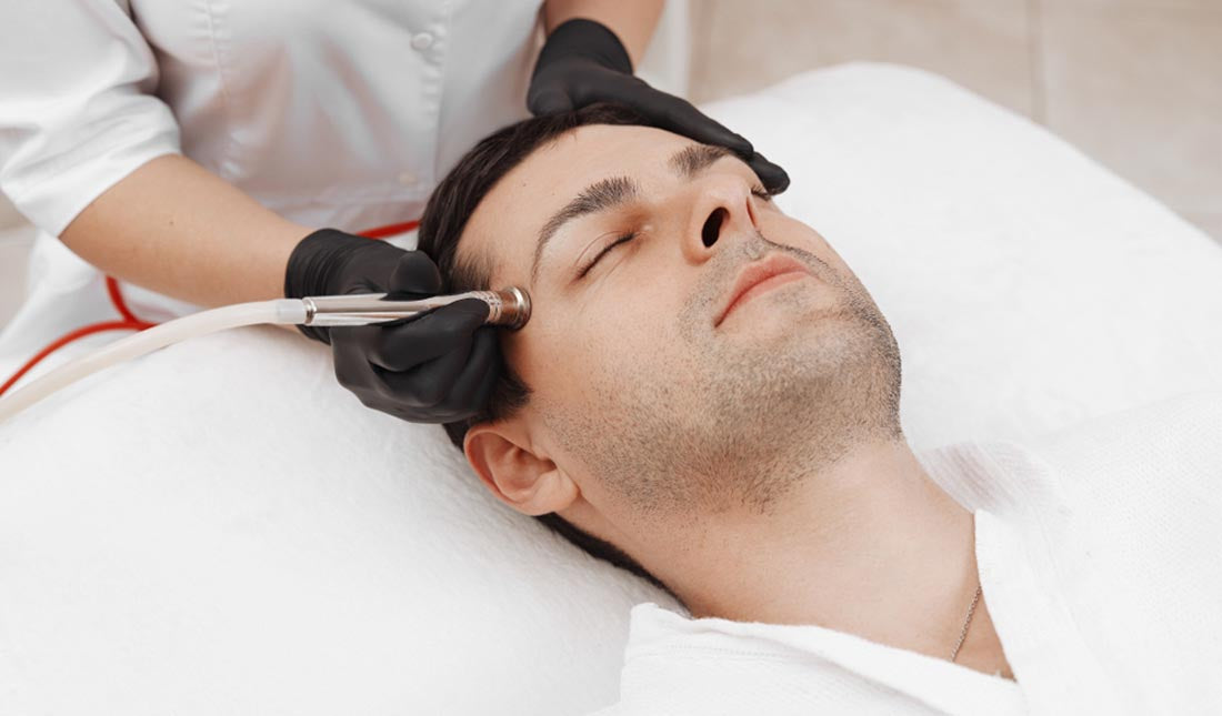 man getting facial dermabrasion