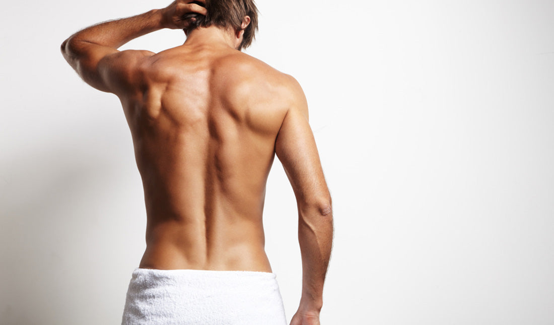 man wearing towel with back exposed
