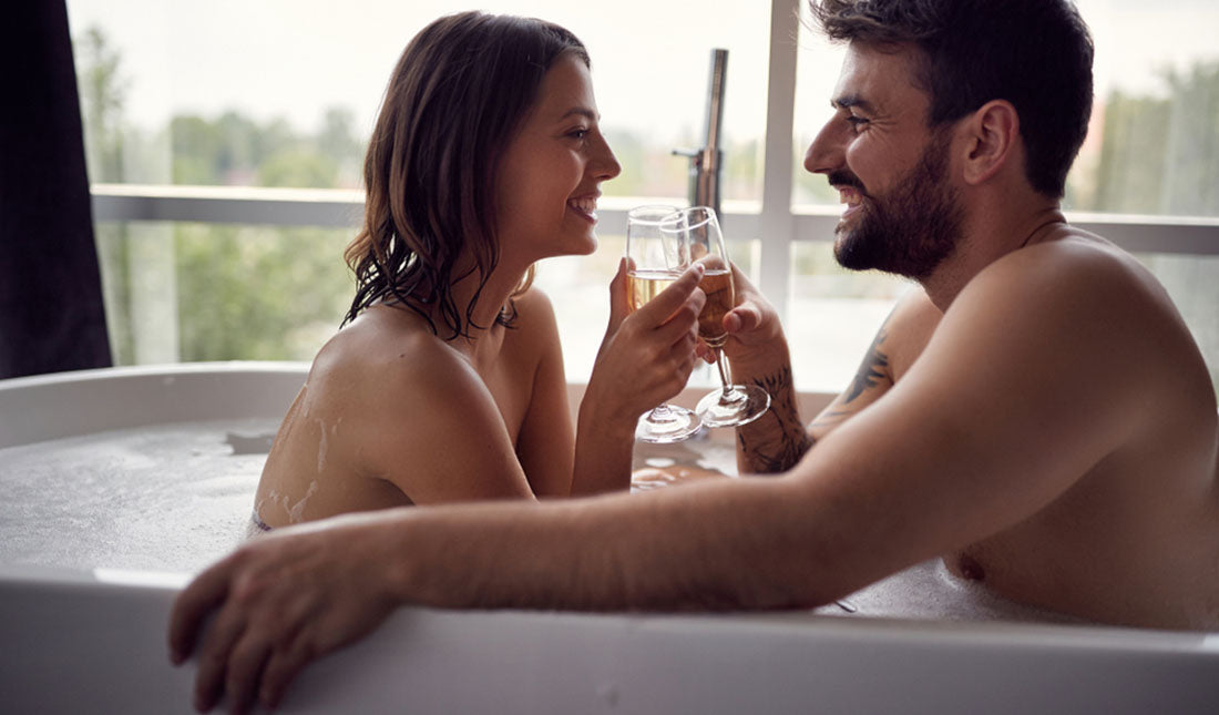 romantic young couple enjoying relaxing bathtub