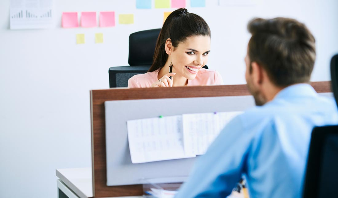 woman smiling at male coworker
