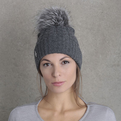 RECYCLED CASHMERE CABLE BEANIE WITH UPCYCLED FUR POM