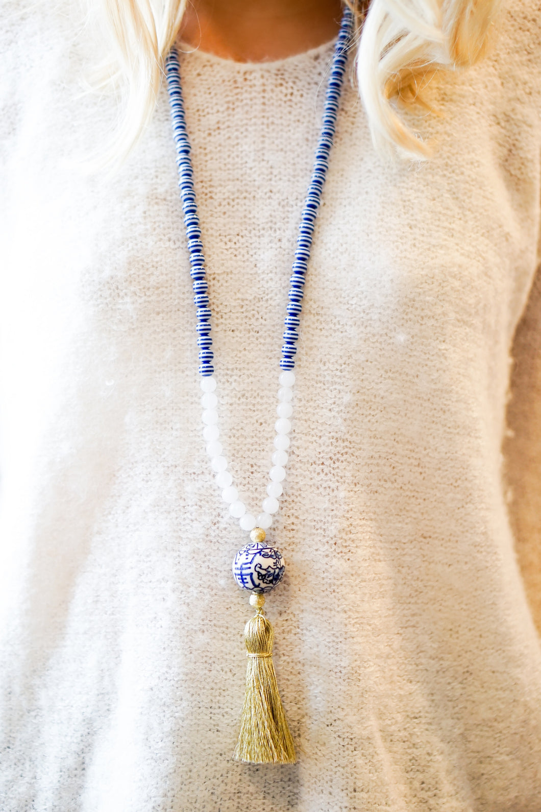 Navy and gold beaded tassel necklace