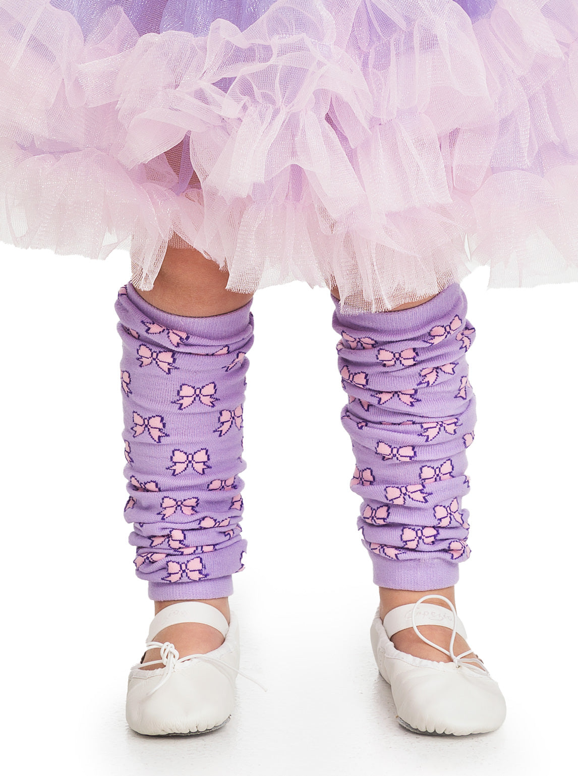 It's irresistible to twirl, jump and dance in this fun, fluffy lilac and pink tutu. Three layers of shimmery lilac fabric are accented by large pink ruffled edges. The soft, elastic waist is detailed with an adorable matching pink ribbon.