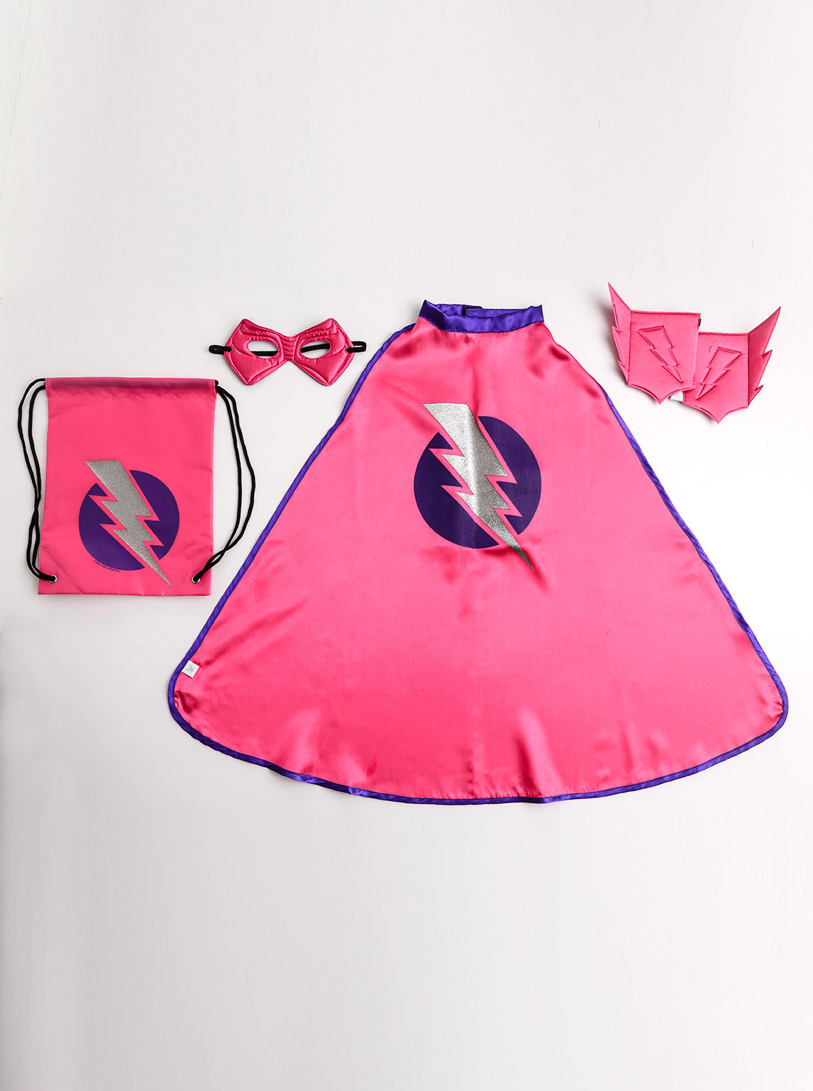 Little Adventures Boy Hero Gift Set is a perfectly packaged hero set that conveniently fits inside its matching drawstring bag. Give as a gift or just because, this Gift Set is all you need! Intended for ages 3-5 this set comes with a Red Hero Cape, Reversible Power Mask, Red Hero Cuffs, and Hero Drawstring Bag.
