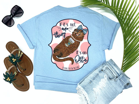 beach tees - if it's not one thing it's an otter - sea otter tee - preppy sea otter holding coffee wearing a bow and pearls with pink polkadot background - blue tshirt - florida fashion - living life in the sun