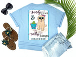 beach tees - sandy paws and salty kisses - dog tee - preppy cute puppy dog wearing sunglasses and bow sitting on beach with bucket of tennis balls - blue tshirt - florida fashion - living life in the sun
