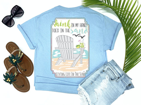 preppy graphic tees - drink in my hand toes in the sand - adirondack beach chair t shirt - adirondack chair on the beach with mojito looking at the sea and seagulls - blue tee - vacation tshirt - living life in the sun
