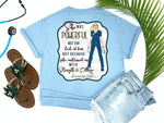 Southern Nurse Tees - living life in scrubs - shirts with sayings - she was powerful not for lack of fear but because she continued on with strength and courage - nurse holding n95 mask - superhero nurse t-shirt - covid 19 coronavirus covid corona tee - inspirational preppy top - cute blonde LPN RN - simply a blue graphic tee