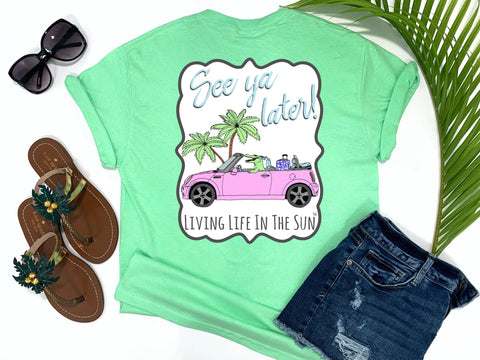 beach tees - see ya later alligator - alligator tee - alligator road tripping in a pink mini cooper convertible passing a palm tree with a bow and suitcase in the back - mint green tshirt - florida fashion - living life in the sun