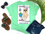 simply southern style - sandy paws and salty kisses - dog shirt - preppy cute puppy dog wearing sunglasses and bow sitting on beach with bucket of tennis balls - mint green t-shirt - coastal vacation gifts - living life in the sun