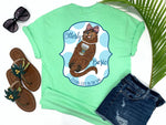 southern beach tees - otterly basic - preppy sea otter holding coffee wearing bow and pearls - mint green shirt - women beach clothes - living life in the sun
