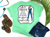Southern Nurse Tees - living life in scrubs - shirts with sayings - she was powerful not for lack of fear but because she continued on with strength and courage - nurse holding n95 mask - superhero nurse t-shirt - covid 19 coronavirus covid corona tee - inspirational preppy top - cute brunette LPN RN - simply a mint green graphic tee