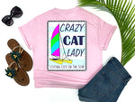 southern beach tees - crazy cat lady - catamaran boat tshirt - hobie cat sailing on blue and white striped nautical background - pink shirt - women beach clothes - living life in the sun