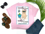 southern beach tees - sandy paws and salty kisses - dog tshirt - preppy cute puppy dog wearing sunglasses and bow sitting on beach with bucket of tennis balls - pink shirt - women beach clothes - living life in the sun
