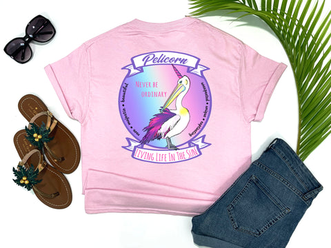 shirts with sayings - never be ordinary - pelicorn t-shirt - a pelican crossed with a unicorn makes a pelicorn with rainbow background - pinkt shirt - southern beach t shirt - living life in the sun