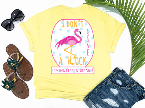 beach tees - i don't give a flock - flamingo tee - idgaf with pink flamingo leg as L and blue polkadot background - yellow tshirt - florida fashion - living life in the sun