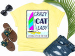 beach tees - crazy cat lady - catamaran boat tee - hobie cat boating shirt on nautical blue and white striped background - yellow tshirt - florida fashion - living life in the sun