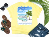 shirts with sayings - as free as the sea - retro vw van t-shirt - retro vw van beside palm tree on beach with waves - yellow t shirt - southern beach t shirt - living life in the sun